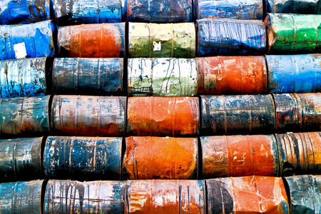 staple: Horizontal staple of colorful used oil drums on a stoage site
