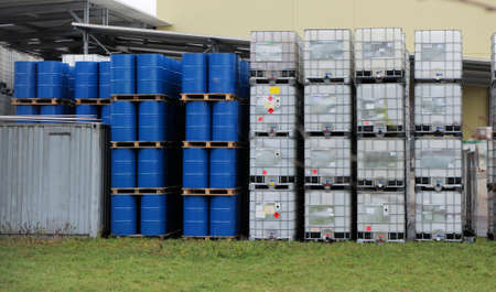 Blue drums and white container in a chemical store