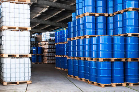 Blue drums and IBC container in a storage room
