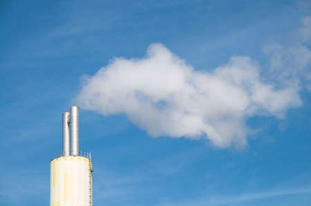 residue: White smoke out of a stack of a waste incineration plant Stock Photo