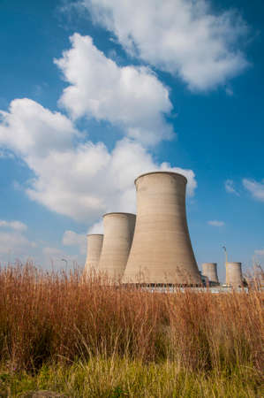 cooling tower: Cooling towers with water clouds of the Grootvlei power plant in South Africa Stock Photo