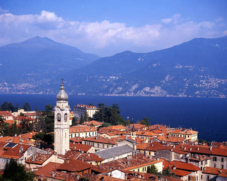View over the town rooftops to Lake Como, Menaggio, Lombardy, Italy, Europe