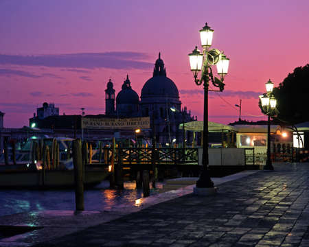 quayside: Quayside and church of Santa Maria Della Salute at sunset, Venice, Veneto, Italy, Europe  Stock Photo
