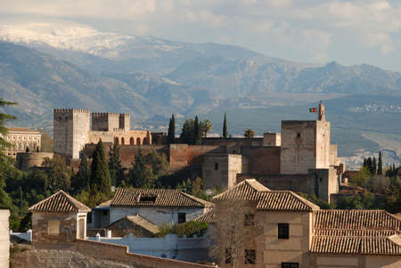 View of the Palace of Alhambra with snow capped mountains of the Sierra Nevada to the rear, Granada, Granada Province, Andalucia, Spain, Western Europe