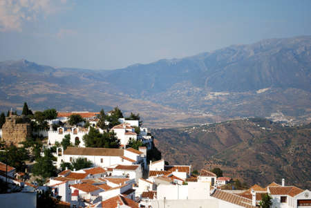 View of the town and castle with Sierra de Tejeda mountains\ to the rear, Comares, Axarquia region, Malaga Province, Andalucia,\ Spain, Western Europe