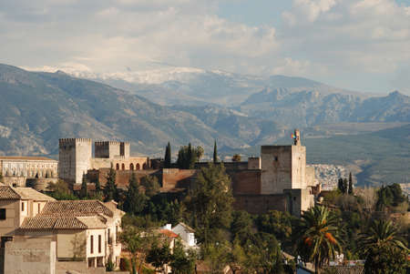 View of the Palace of Alhambra with snow capped mountains of the Sierra Nevada to the rear, Granada, Granada Province, Andalucia, Spain, Western Europe  photo