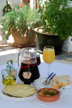 A selection of tapas with a jug of Sangria and orange juice, Sliced Manchego cheese, and green olive cocktail, Costa del Sol, Malaga Province, Andalucia, Spain, Western Europe  Stock Photo - 13288216