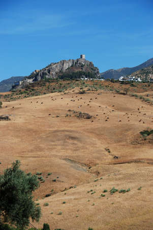 View of the town with a castle on top of the hill, Zahara de la Sierra, Cadiz Province, Andalucia, Spain, Western Europe  photo