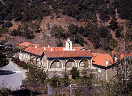 11th century: The Holy, Royal and Stavropegic Monastery of Kykkos with the Troodos Mountains to the rear, Cyprus  Stock Photo