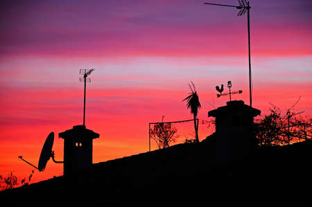 Mediterranean sunset over house rooftops, Costa del Sol, Malaga Province, Andalucia, Spain, Western Europe  Stock Photo - 13291272