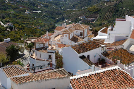 View over the town rooftops and surrounding countryside, Frigiliana, Malaga Province, Andalucia, Spain, Western Europe