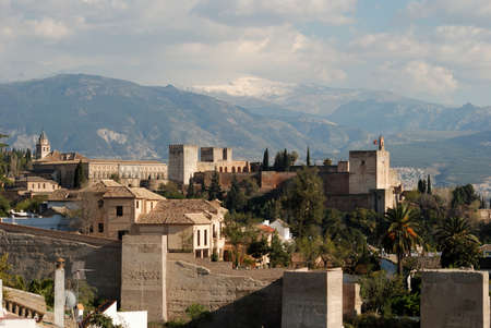 sierra snow: View of the Palace of Alhambra with snow capped mountains of the Sierra Nevada to the rear, Granada, Granada Province, Andalucia, Spain, Western Europe