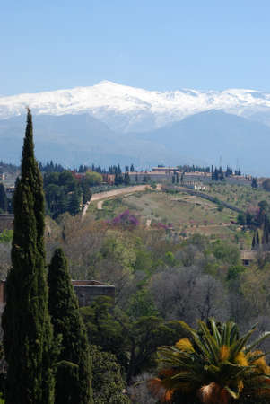 View towards the snowy Sierra Nevada Mountains seen from the castle, Palace of Alhambra, Granada, Granada Province, Andalucia, Spain, Western Europe Stock Photo - 13291480