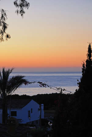 View over villa rooftop to the Mediterranean sea at sunrise, Calypso, Mijas Costa, Malaga Province, Costa del Sol, Andalucia, Spain, Western Europe  photo