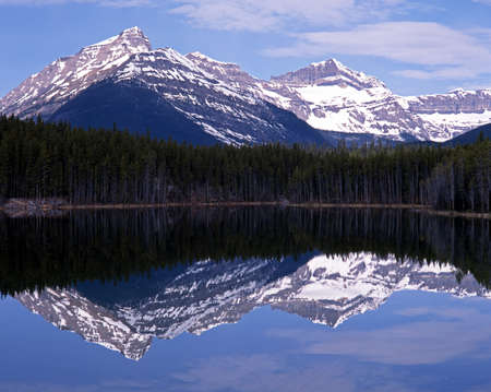 View across Herbert lake with snow capped mountains to the rear, Alberta, Canada Stock Photo - 13509295