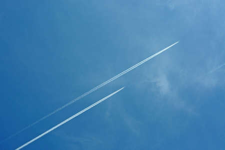 Two aeroplanes flying high in the sky leaving vapour trails, Malaga Province, Andalucia, Spain, Western Europe  photo