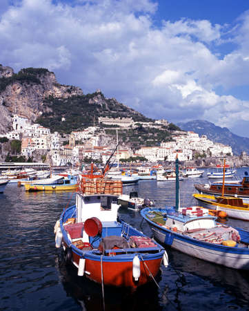 Traditional fishing boats in the harbour, Amalfi, Amalfi Coast, Campania, Italy, Europe