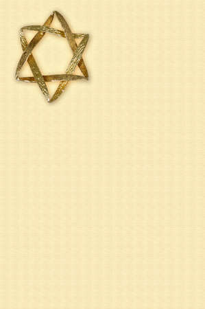 Star of David pendant with an outer glow on a cream coloured background  photo