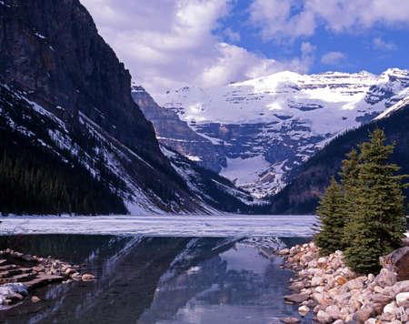 View across a part frozen Lake Louise, Banff National Park, Alberta, Canada Stock Photo - 13623860