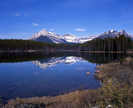 View across Herbert lake with snow capped mountains to the rear, Icefield Parksway, Alberta, Canada  Stock Photo - 13662128