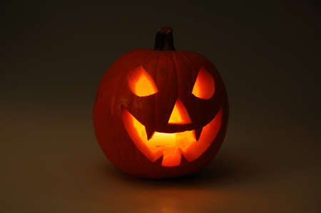 Scary face cut into pumpkin for Halloween  lit from the inside , Urbanisation Calypso, Mijas Costa, Costa del Sol, Malaga Province, Andalucia, Spain, Western Europe  Stock Photo