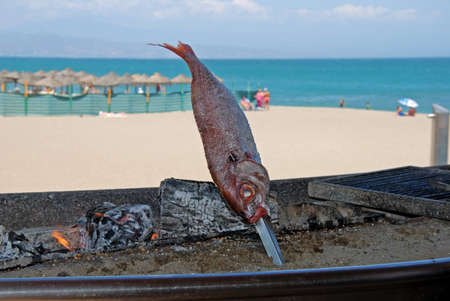 costa del sol: Fish cooking at a beachside restaurant, Benalmadena Costa, Costa del Sol, Malaga Province, Andalucia, Spain, Western Europe  Stock Photo