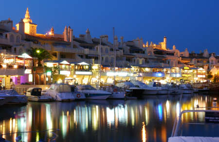 del: View of yachts and restaurants in the harbour at dusk, Benalmadena, Costa del Sol, Malaga Province, Andalucia, Spain, Western Europe  Stock Photo