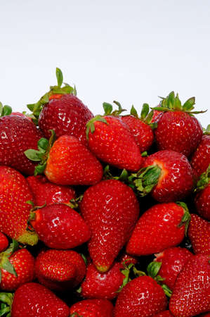 Whole fresh strawberries against a white background, Malaga Province, Andalucia, Spain, Western Europe  Stock Photo