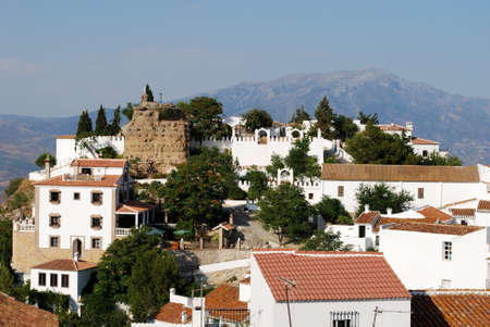 View of the town and castle with mountains to the rear, Comares, Axarquia region, Malaga Province, Andalucia, Spain, Western Europe  Stock Photo - 13976441