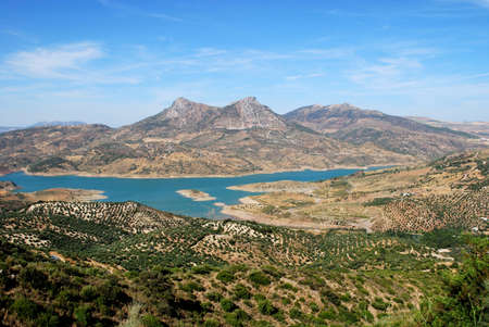 View across olive trees and the reservoir towards the mountains, Zahara de la Sierra, Cadiz Province, Andalucia, Spain, Western Europe  photo