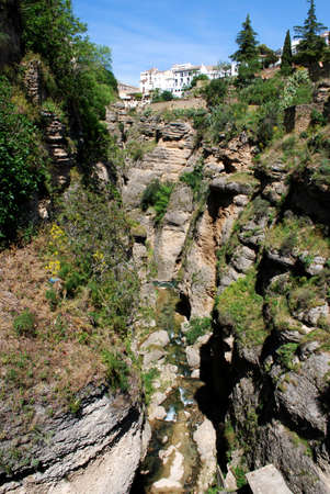 View of the gorge from the old bridge  Puente Viejo , Ronda, Andalusia, Western Europe  photo