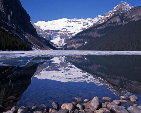 View across a part frozen Lake Louise, Banff National Park, Alberta, Canada  Stock Photo - 14631801