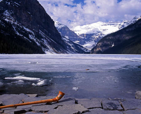 louise: Partly frozen Lake Louise with horn in foreground, Banff National Park, Alberta, Canada. Stock Photo