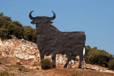 Osborne bull on hillside near Estepa, Seville Province, Andalusia, Spain, Western Europe. Stock Photo