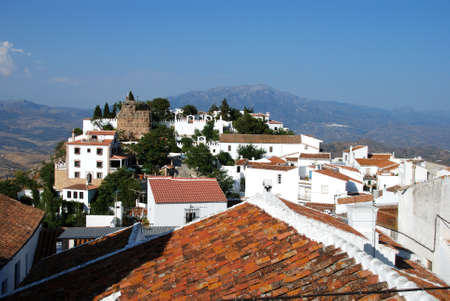 View of the town and castle with mountains to the rear, Comares, Axarquia region, Malaga Province, Andalucia, Spain, Western Europe  Stock Photo - 14835306