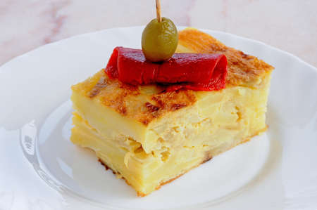 Tapas of Spanish tortilla topped with red pepper and a green olive, Andalusia, Spain, Western Europe