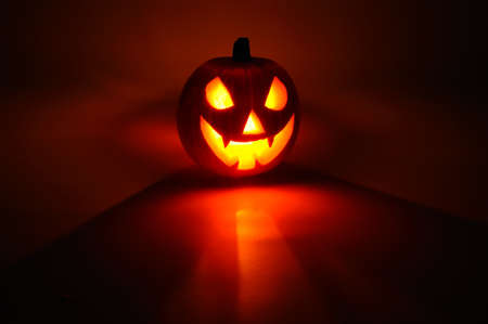 Scary face cut into pumpkin for Halloween  lit from the inside , Western Europe Stock Photo - 14883936