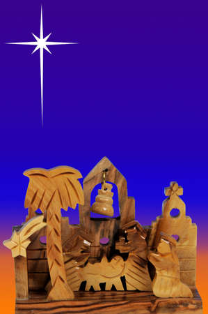 Houten kerststal tegen nachtelijke hemel met ster Stockfoto