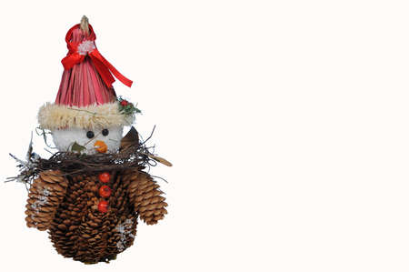 Snowman made from pine cones against a white background  Stock Photo - 15217634