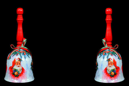 Two Christmas hand bells against a black background Stock Photo - 15217633