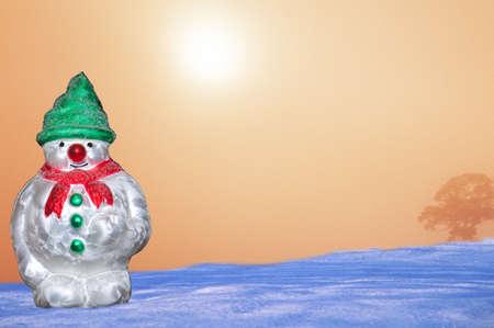 Glass Christmas snowman ornament against a snowy sunrise, Staffordshire, England, UK Stock Photo - 15217644