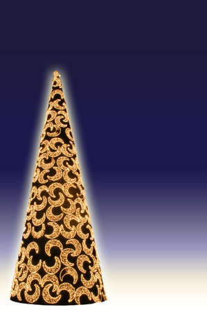 Conical shaped Christmas tree with moon decorations against a blue background with copy space Stock Photo - 15725517