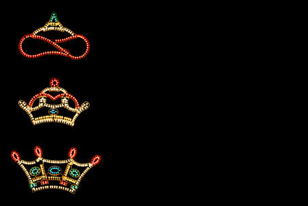 Three Kings Crowns against black background with copy space
