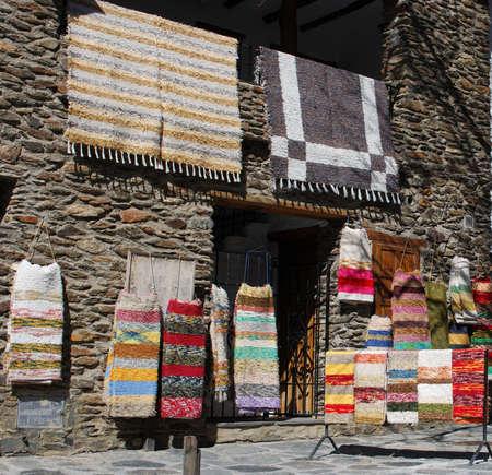 mementos: Rug shop in the main street, Bubion, Las Alpujarras, Granada Province, Andalusia, Spain, Western Europe