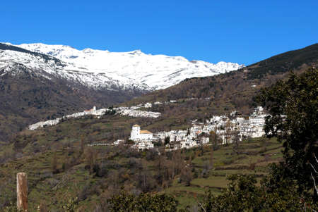 General view of town with Capileira to and snow capped mountains to rear, Bubion, Las Alpujarras, Granada Province, Andalusia, Spain, Western Europe Stock Photo - 16627232