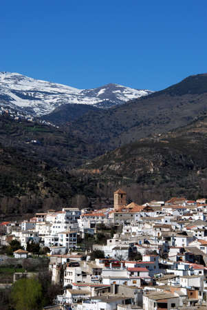 alpujarra: View of white village with the Sierra Nevada mountains to the rear, Cadiar, Las Alpujarras, Granada Province, Spain, Western Europe