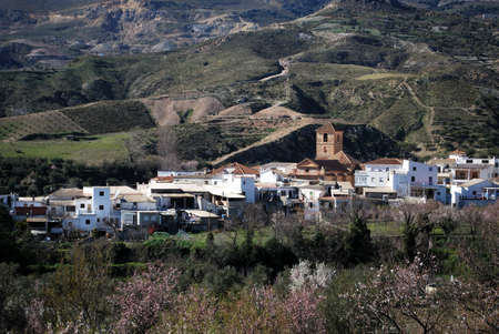 View of white village with the Sierra Nevada mountains to the rear, Cadiar, Las Alpujarras, Granada Province, Spain, Western Europe Stock Photo - 16627518