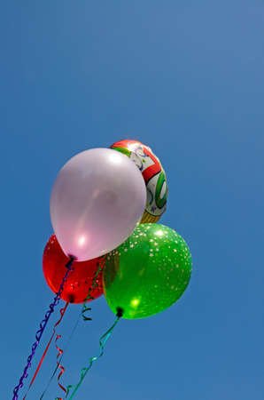 seventieth: Bunch of balloons against a blue sky