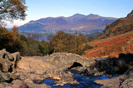 borrowdale: View of Bridge over Barrow Beck with Derwent Water to the rear, near Keswick, Borrowdale, Yorkshire Dales, England, Western Europe