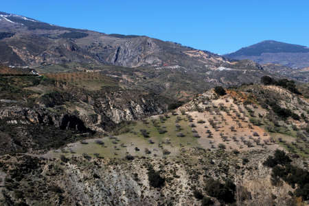 View of the countryside and Sierra Nevada mountains near Torvizcon, Las Alpujarras, Granada Province, Andalucia, Spain, Western Europe  photo